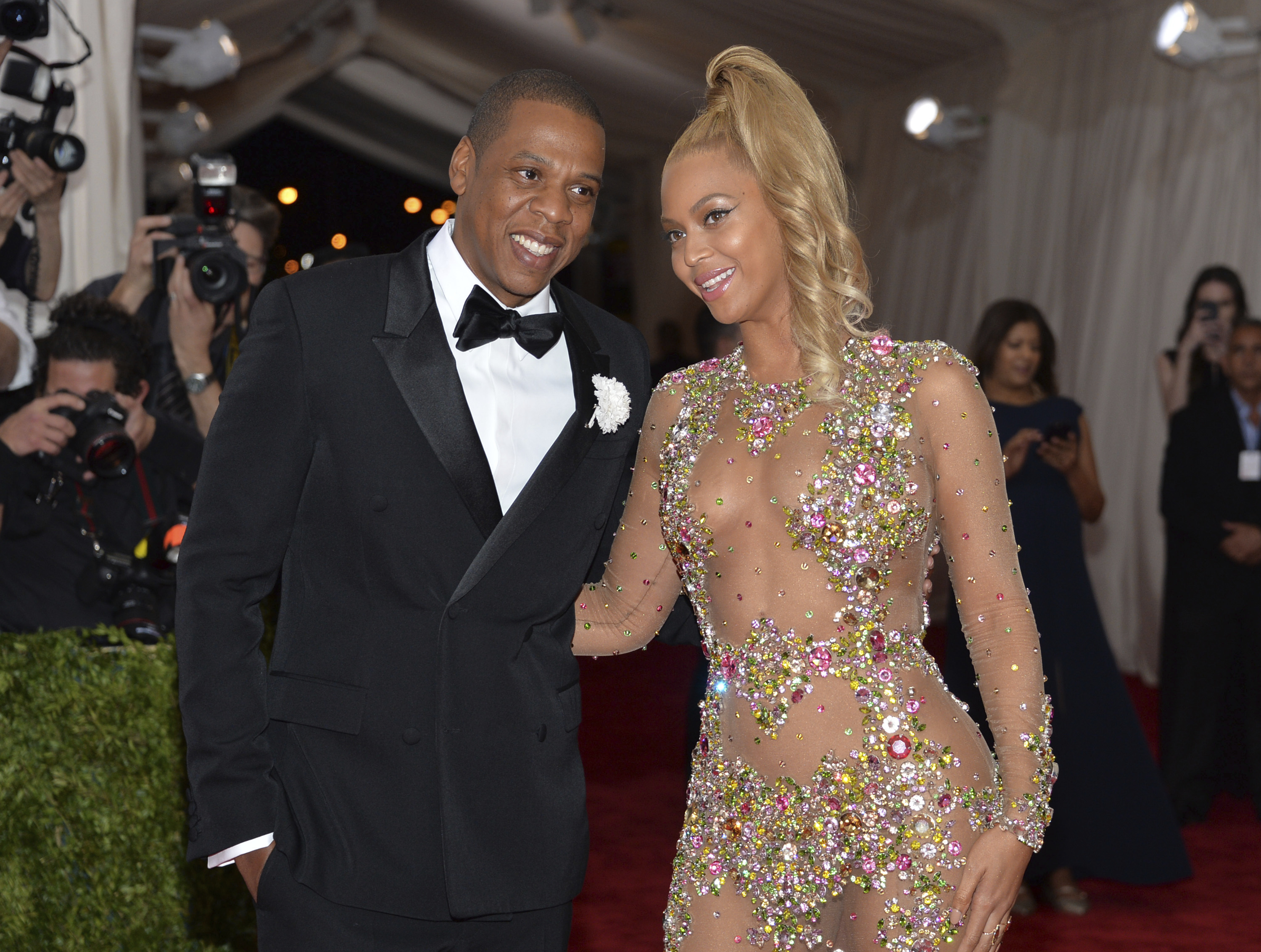"FILE- In this May 4, 2015, file photo, Jay Z, left, and Beyonce arrive at The Metropolitan Museum of Art's Costume Institute benefit gala celebrating ""China: Through the Looking Glass"" in New York. After bad weather forced concertgoers at the MetLife Stadium inside for close to an hour Thursday night, Aug. 2, 2018, Beyonce and Jay-Z hit the stage at 11:08 p.m. and played into Friday morning, wrapping the energetic show at 1:29 a.m. (Photo by Evan Agostini/Invision/AP, File)"