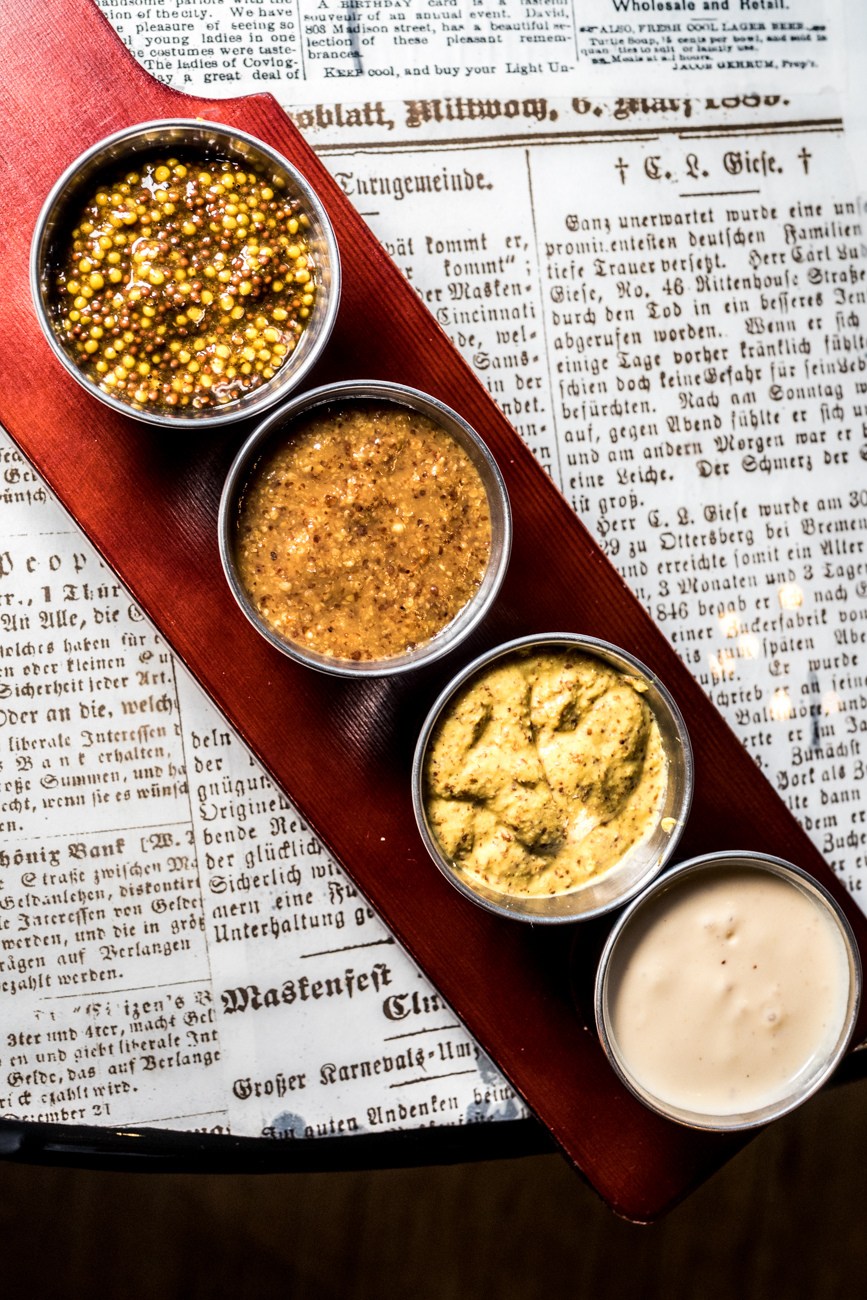 Dip flight of mustards with beer cheese / Image: Catherine Viox{ }// Published: 12.17.19