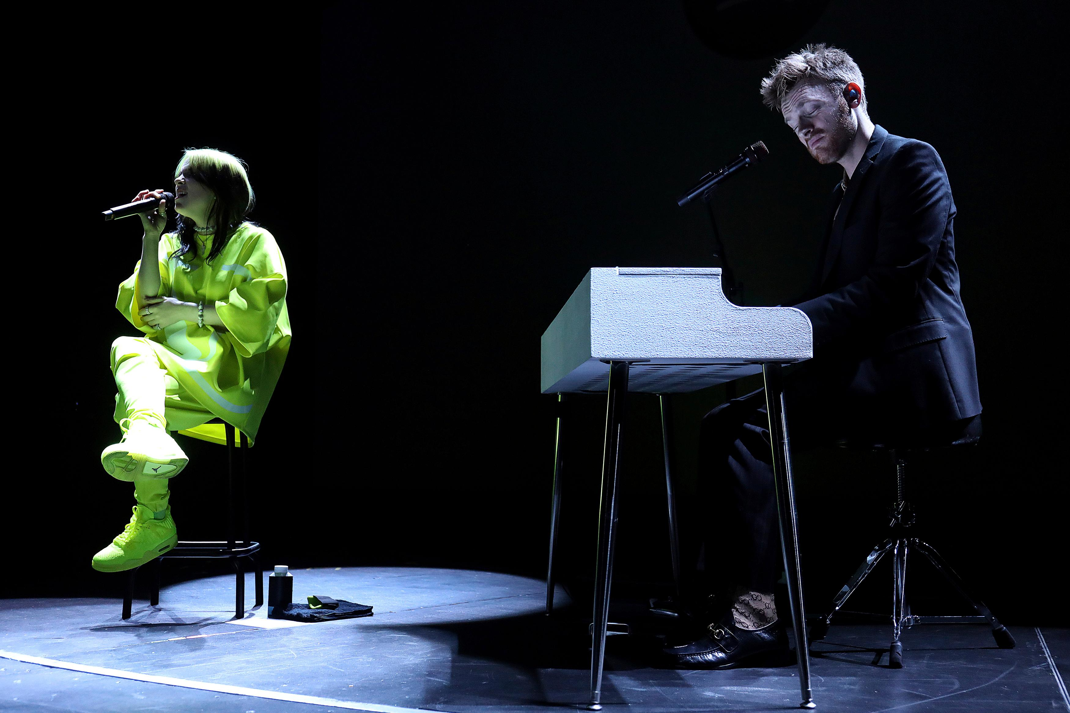 Billie Eilish, left, and her brother Finneas O'Connell perform live on stage at the 2020 Spotify Best New Artist Party at The Lot Studios on Thursday, Jan. 23, 2020, in West Hollywood, Calif. (Photo by Willy Sanjuan/Invision/AP)