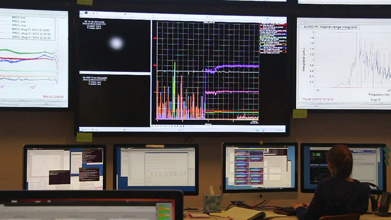 "The monitors on the wall in LIGO's control room indicate that part of the detector is ""locked."" Essentially, lock means the alignment of the laser light and mirrors. LIGO is locked in sections. (Photo: Steve Benham/KATU.com)"
