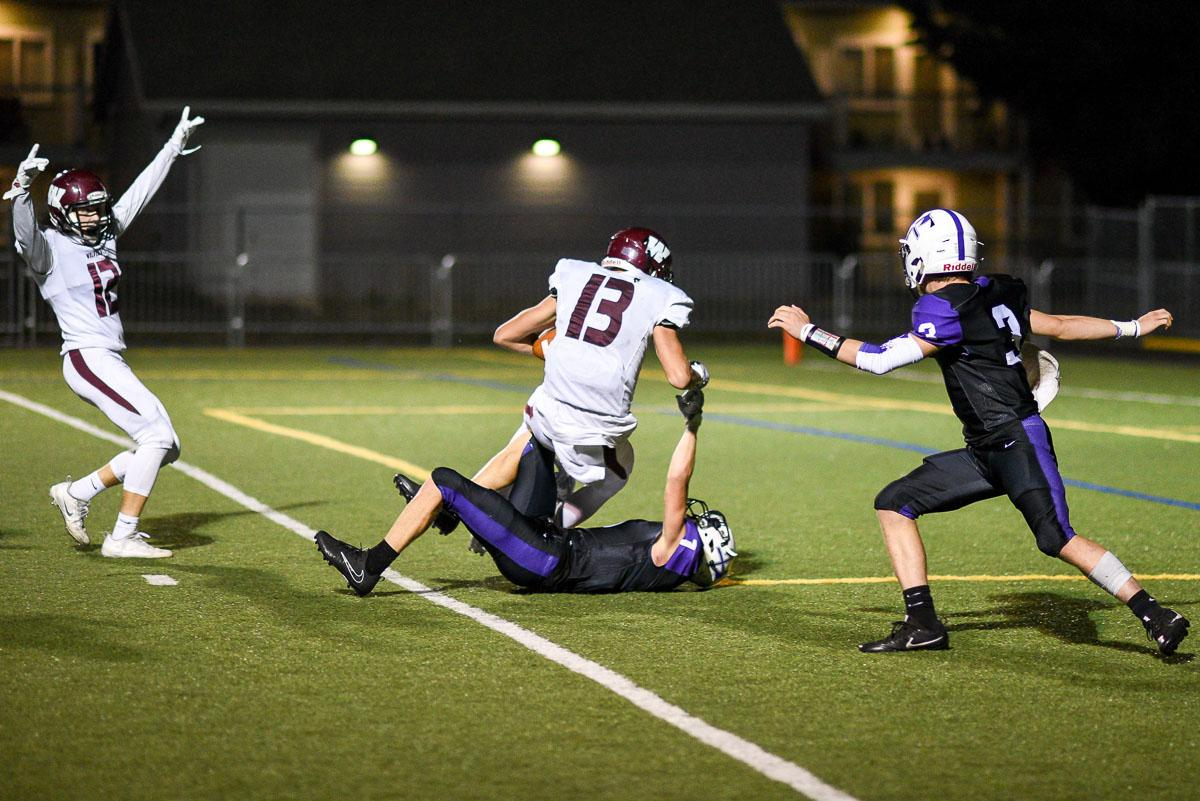 Willamette Wolverines WR Bryce Goggin (#13) falls into the endzone for a touchdown.  Willamette defeated South Eugene 31-8 at South.  Photo by Jeff Dean, Oregon New Lab