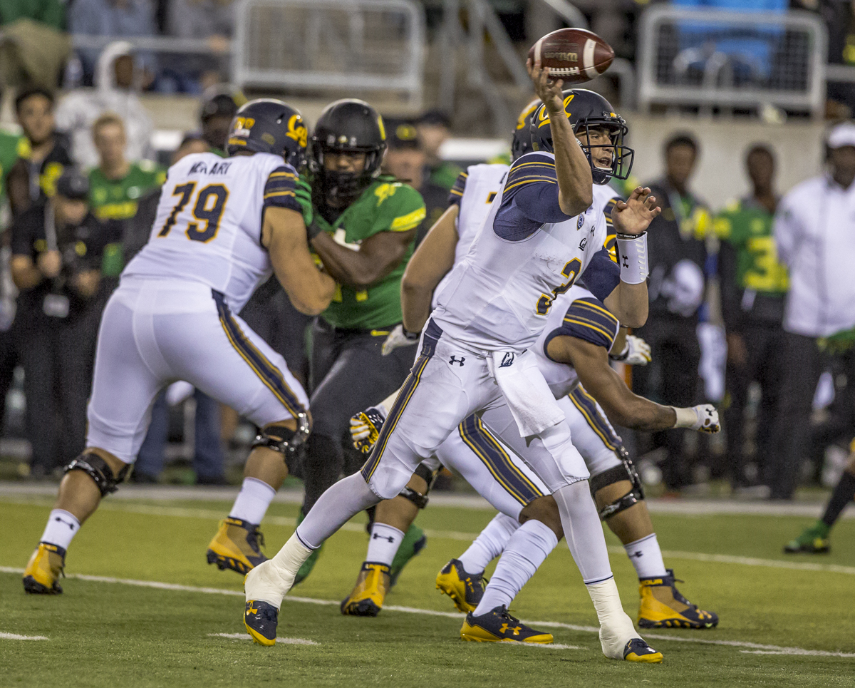 California quarterback Ross Bowers (#3) makes a pass to the wide receiver. The Oregon Ducks defeated the California Golden Bears 45 to 24 during an evening game on Saturday September 30, 2017. Photo by Ben Lonergan, Oregon News Lab