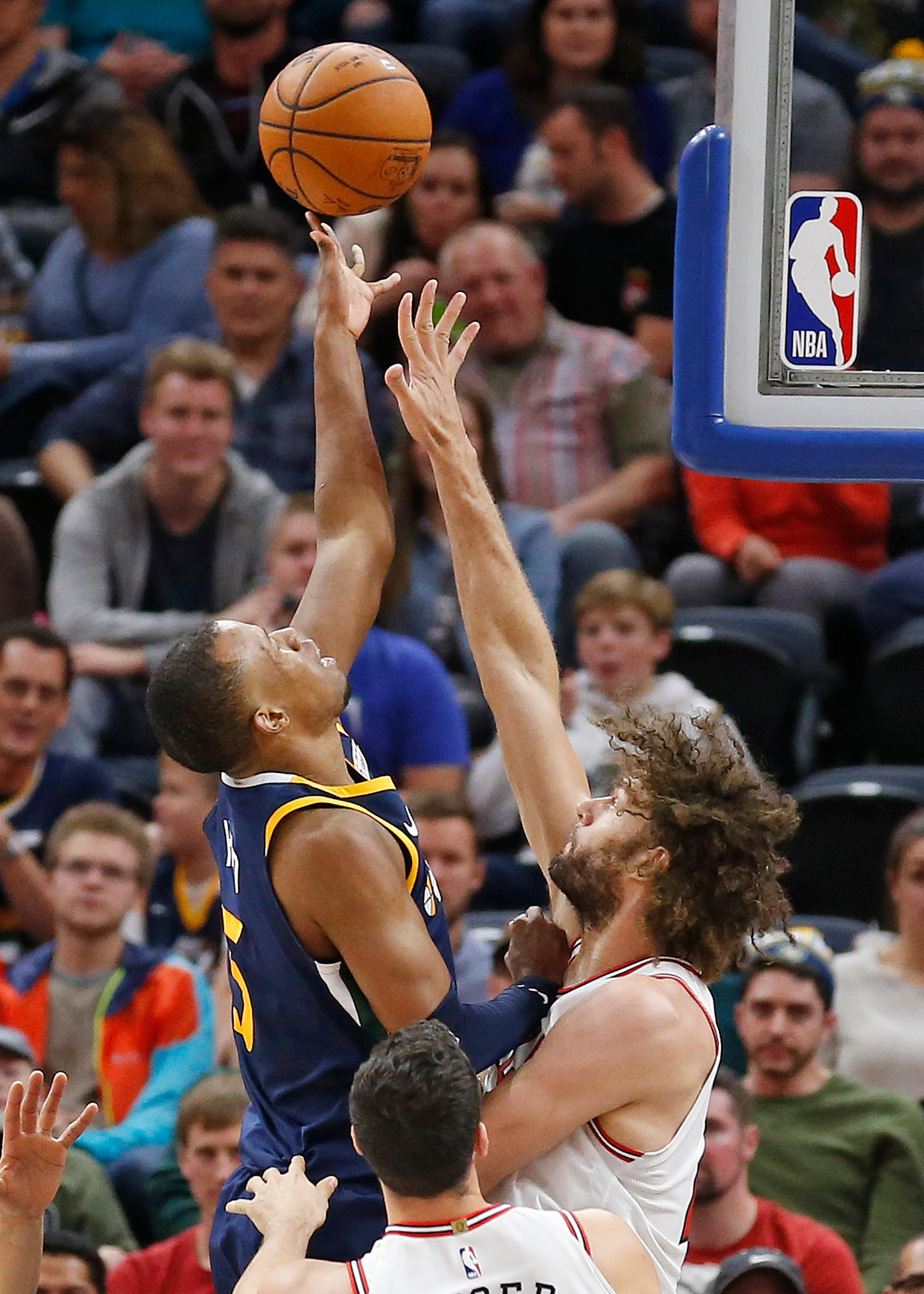 Chicago Bulls center Robin Lopez, right, defends as Utah Jazz guard Rodney Hood shoots during the first half of an NBA basketball game Wednesday, Nov. 22, 2017, in Salt Lake City. (AP Photo/Rick Bowmer)