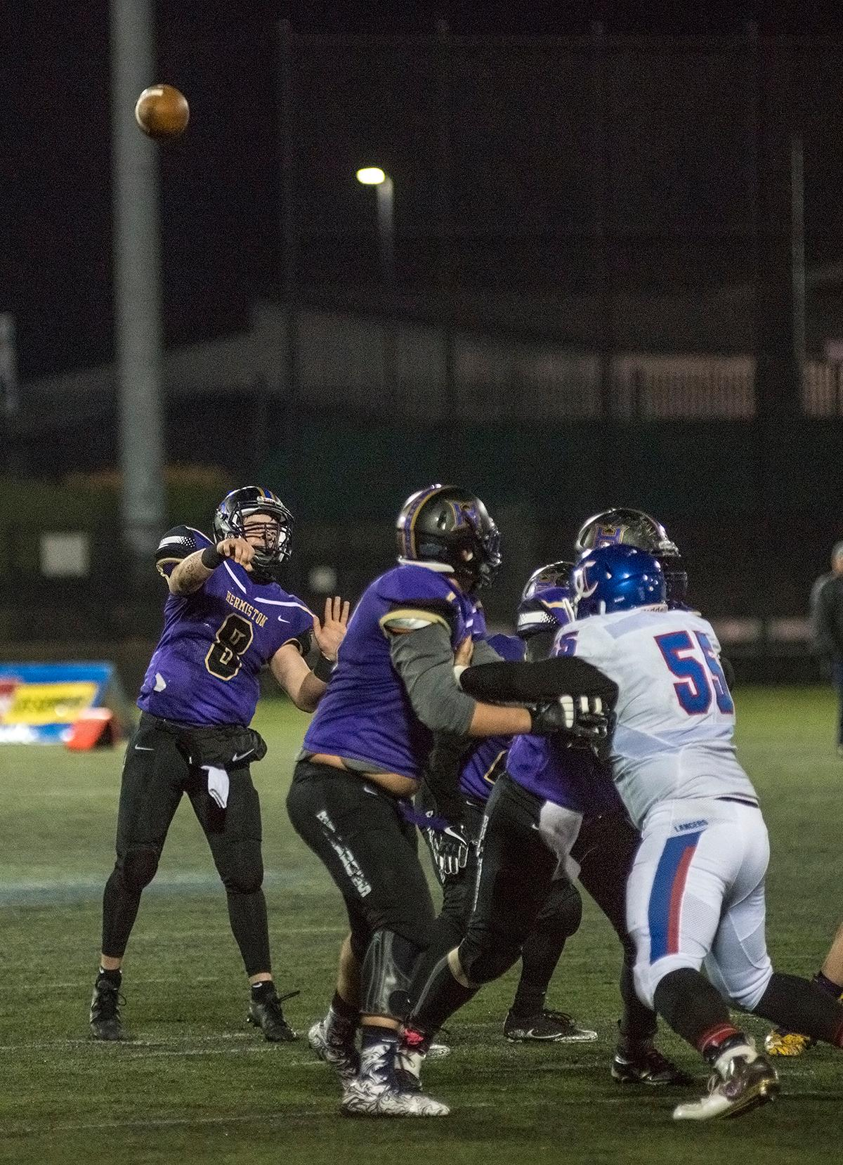 Hermiston Bulldogs quarterback Andrew James (#8) throws deep downfield.The Hermiston Bulldogs defeated the Churchill Lancers 38-35 for the 5A state title Saturday evening at Hillsboro Stadium. Photo by Abigail Winn, Oregon News Lab