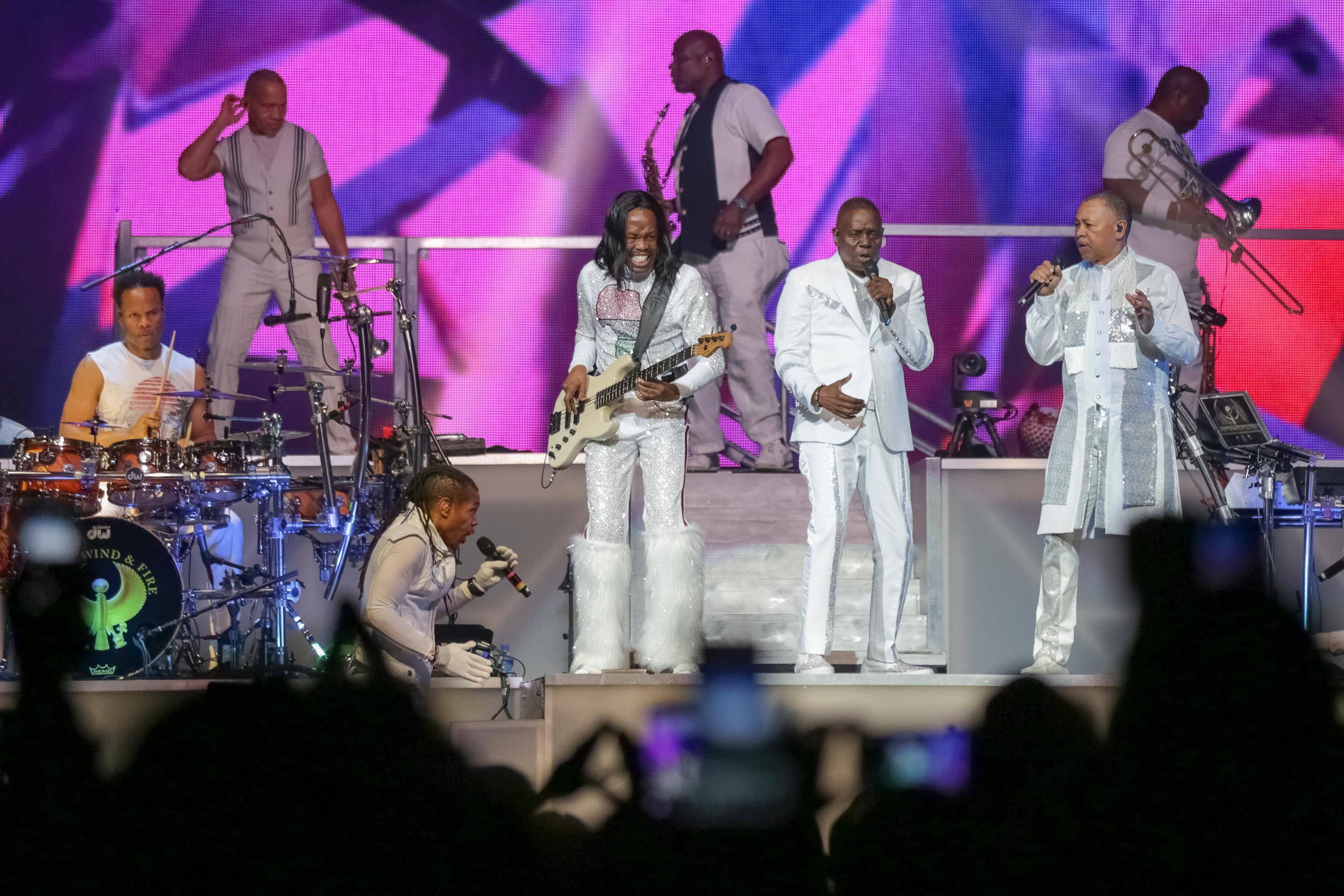 FILE - In this Aug. 9, 2017 file photo, Earth, Wind and Fire performs on stage at the Verizon Center on in Washington. Iconic actress Sally Field and foundational children's show Sesame Street top this year's class of Kennedy Center Honors recipients. Other chosen to receive the award for lifetime achievement in the arts include singer Linda Ronstadt, conductor Michael Tilson Thomas and the R&B group Earth, Wind and Fire.(Photo by Brent N. Clarke/Invision/AP)