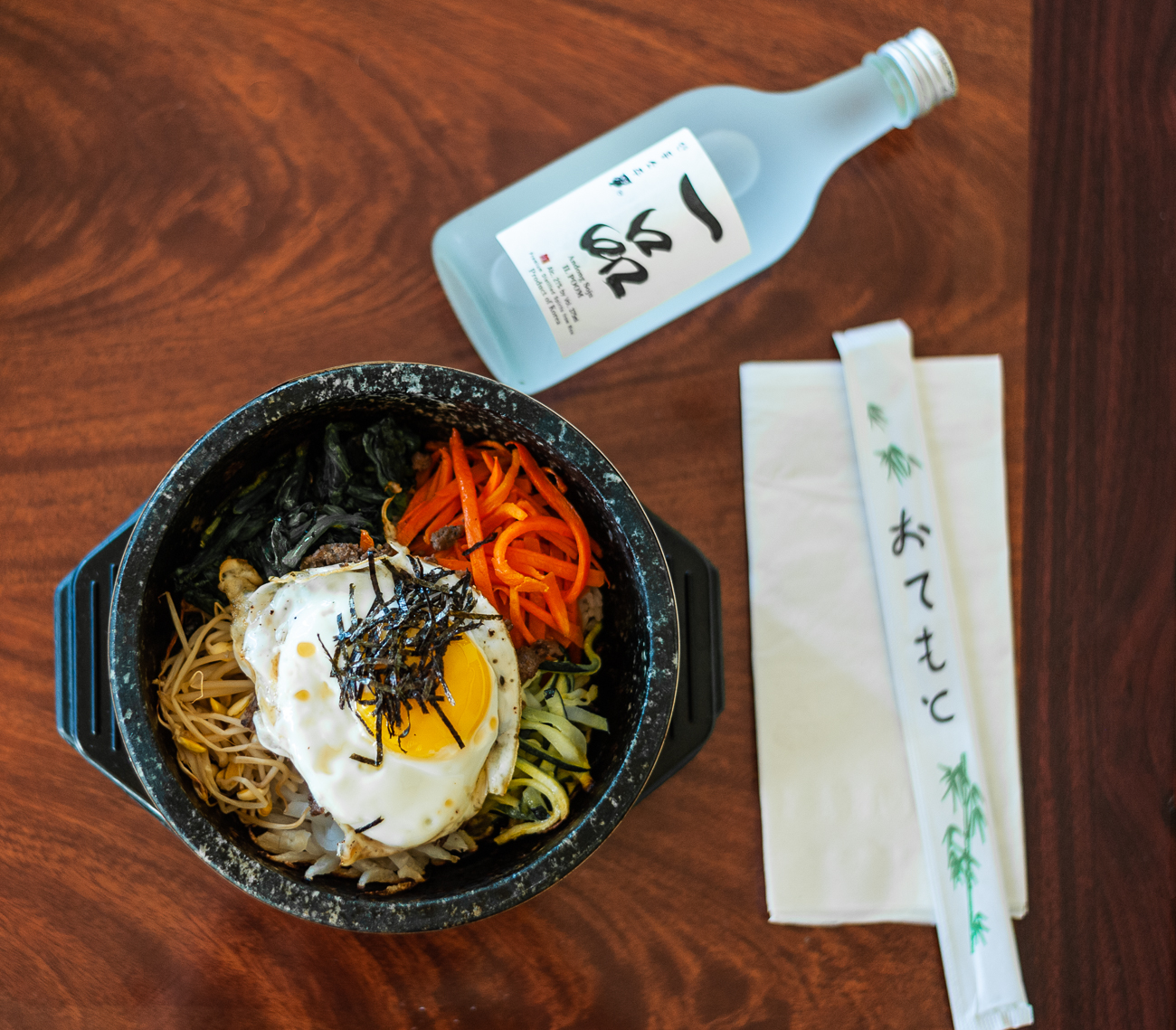 Dolsot Bibimbap served with Saki / Image: Kellie Coleman // Published: 12.29.20<p></p>