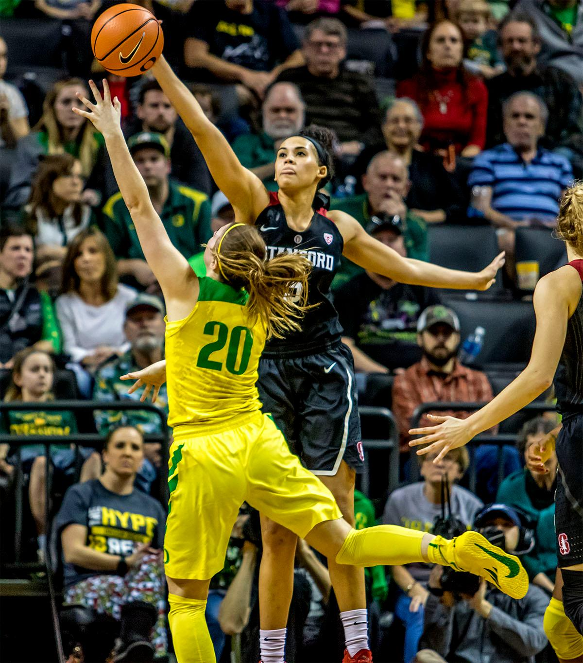 Standord's Kaylee Johnson (#5) blocks the Duck's Sabrina Ionescu's (#20) shot. The Stanford Cardinal defeated the Oregon Ducks 78-65 on Sunday afternoon at Matthew Knight Arena. Stanford is now 10-2 in conference play and with this loss the Ducks drop to 10-2. Leading the Stanford Cardinal was Brittany McPhee with 33 points, Alanna Smith with 14 points, and Kiana Williams with 14 points. For the Ducks Sabrina Ionescu led with 22 points, Ruthy Hebard added 16 points, and Satou Sabally put in 14 points. Photo by August Frank, Oregon News Lab