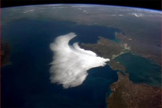Clouds swoop in on Crimea, a white bird on the Black Sea. (Photo & Caption: Col. Chris Hadfield, NASA)