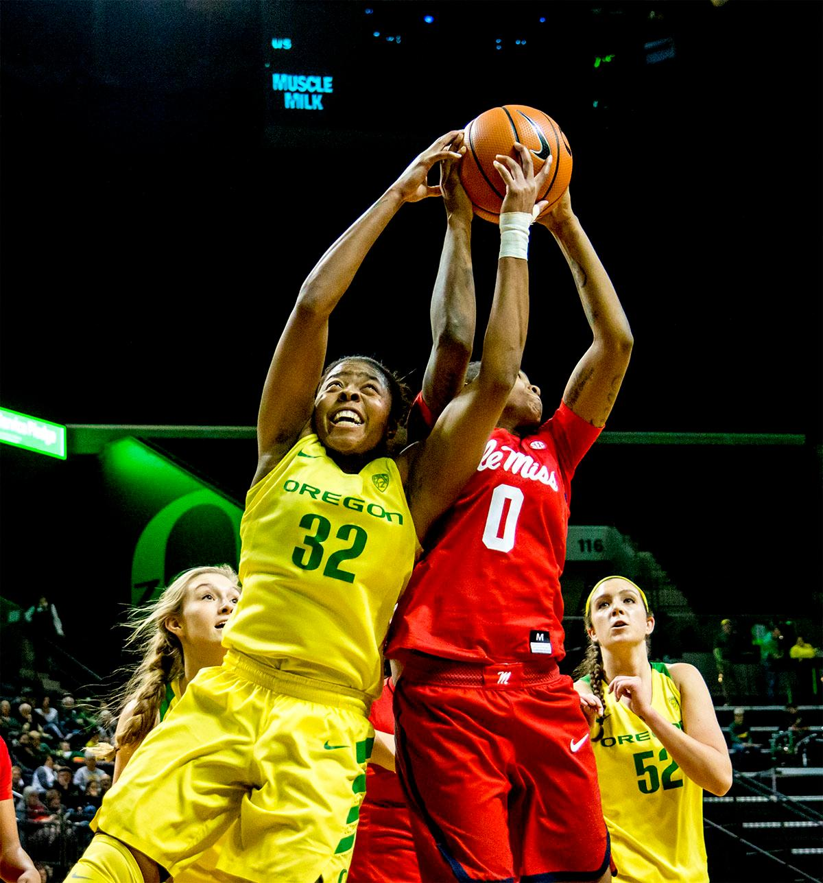 The Duck's Oti Gildon (#32) jumps to try and catch the rebound. The Duck's Sabrina Ionescu (#20) is introduced at the start of the game against the Ole Miss Rebels. The Oregon Ducks womens basketball team defeated the Ole Miss Rebels 90-46 on Sunday at Matthew Knight Arena. Sabrina Ionescu tied the NCAA record for triple-doubles, finishing the game with 21 points, 14 assists, and 11 rebounds. Ruthy Hebard added 16 points, Satou Sabally added 12, and both Lexi Bando and Maite Cazorla scored 10 each. The Ducks will next face off against Texas A&M on Thursday Dec. 21 and Hawaii on Friday Dec. 22 in Las Vegas for Duel in the Desert before the start of Pac-12 games. Photo by August Frank, Oregon News Lab