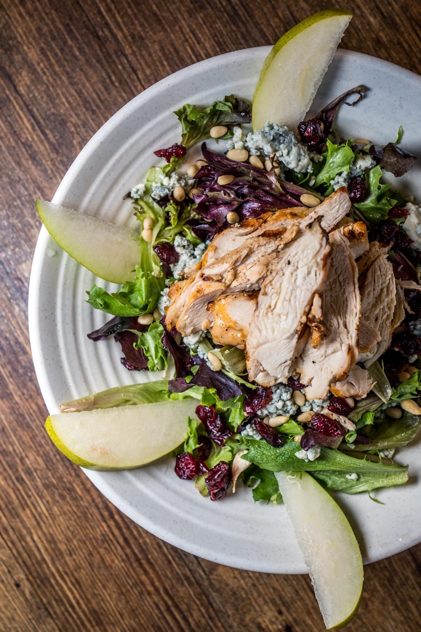 Gorgonzola Pear & Chicken Salad: chicken breast over a bed of mixed greens topped with pairs, pine nuts, dried cranberries, and Gorgonzola cheese with a mustard vinaigrette / Image: Catherine Viox // Published: 3.7.20