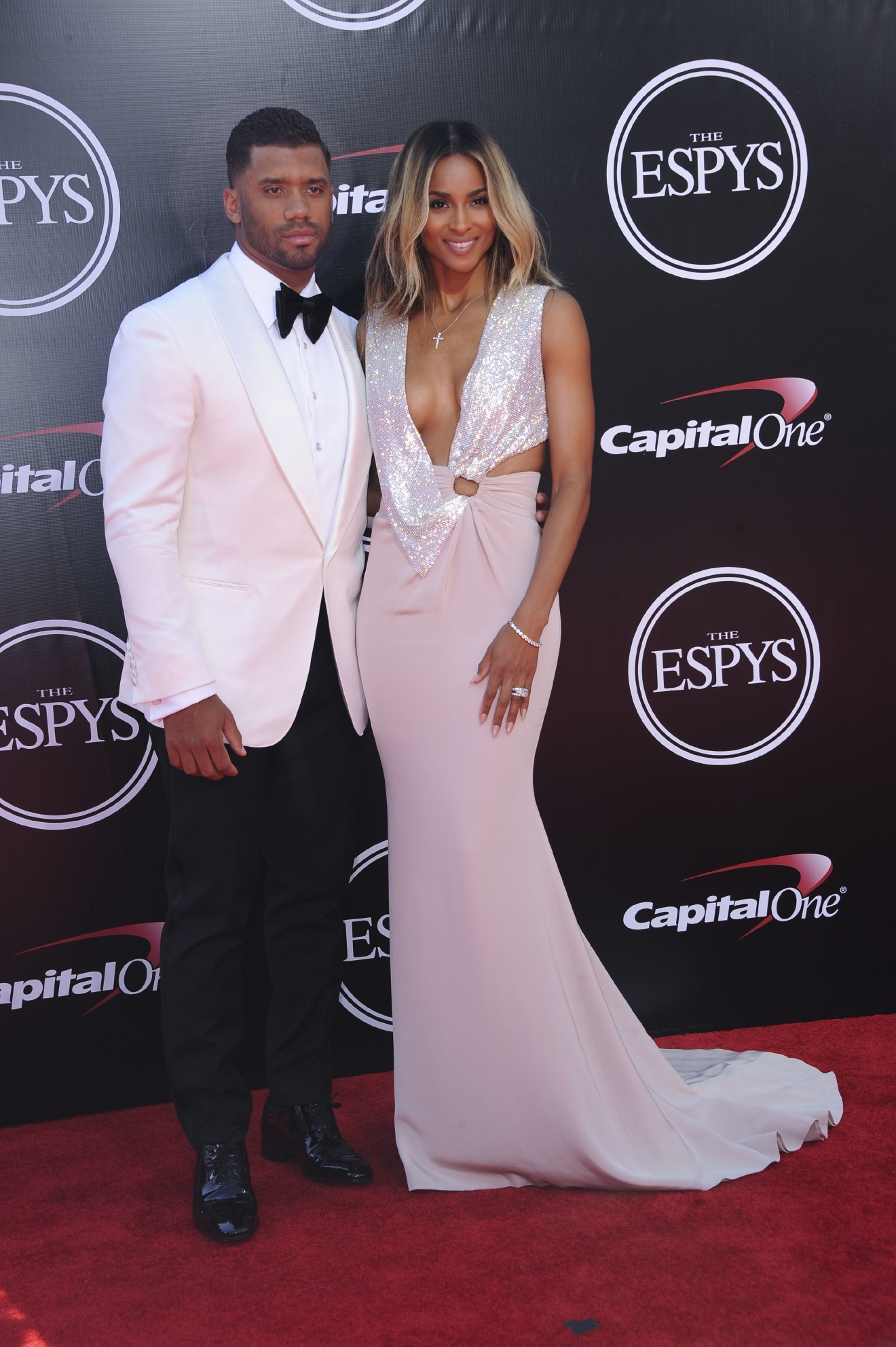 Marriage looks good on these two! Barely a week after their UK marriage, Russell Wilson and Ciara stun on the ESPYs red carpet. Mrs. Wilson wore Roberto Cavalli, and her husband donned Tom Ford.  (Image: Apega/WENN.com)