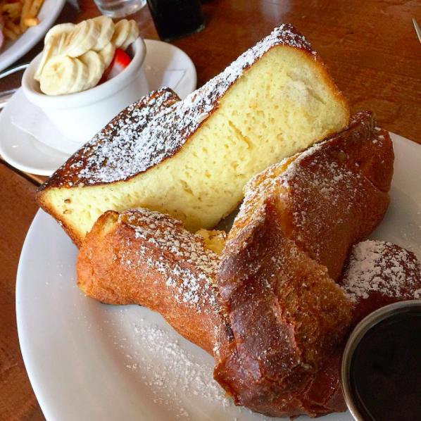 IMAGE: IG user @little_jackjack / POST: My first meal in NY was so fluffy and delicious. Vanilla Bean French Toast: brioche bread, creme brûlée batter, and Vermont maple syrup with fruit added on the side. #foodprivileged