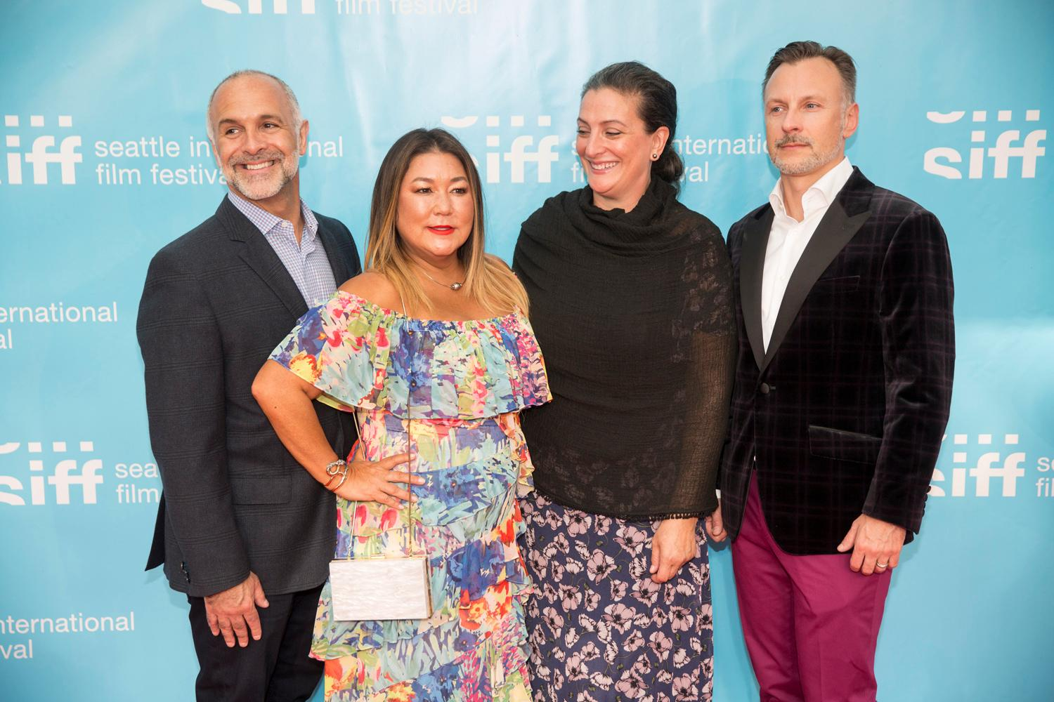 Filmmakers and guests walk the red carpet which marks the beginning of the 25-day Seattle International Film Festival at Seattle Center's McCaw Hall. (Sy Bean / Seattle Refined)