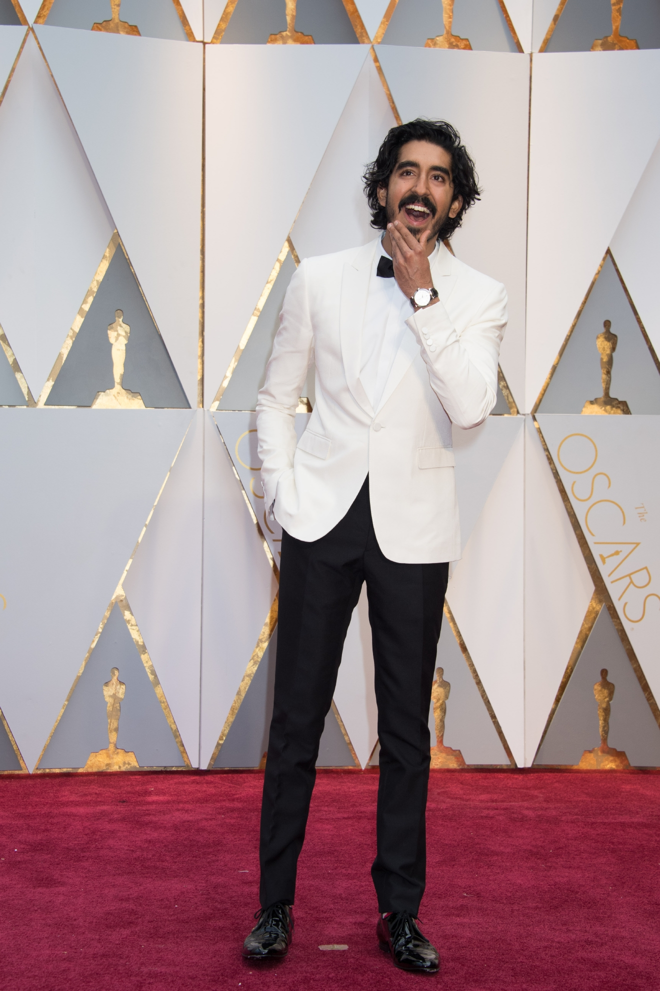 #2: Dev Patel. The white jacket can be hard to pull off, but Dev does it perfectly -  armed with a black bowtie and that smile. (Image: AMPAS)