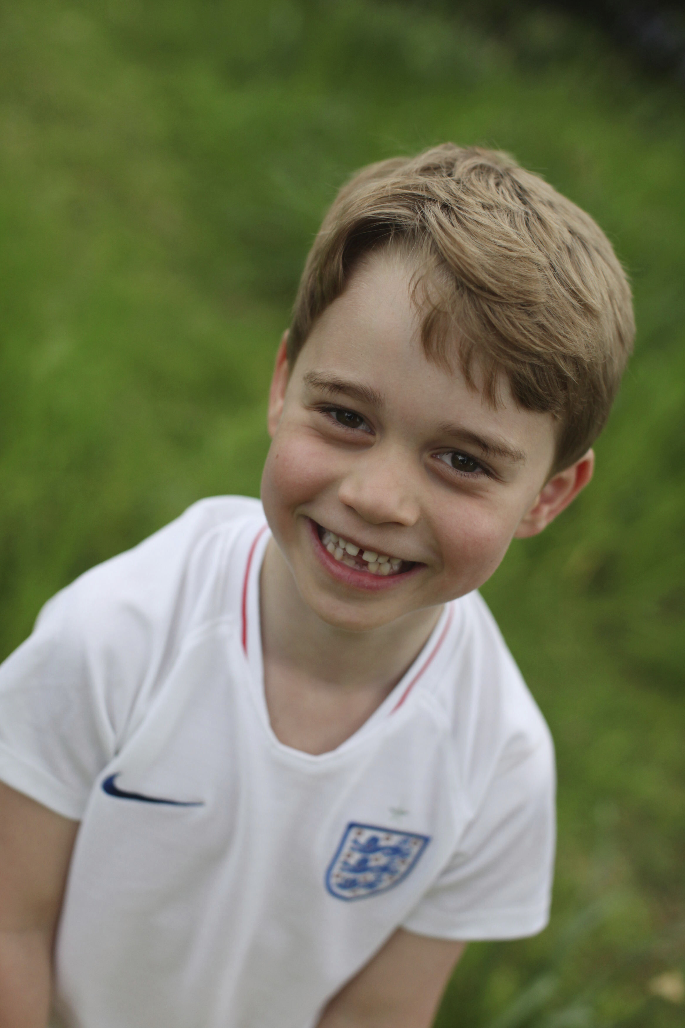 In this undated photo released by the Duke and Duchess of Cambridge on Sunday, July 21, 2019, Britain's Prince George poses for a photo taken by his mother, Kate, the Duchess of Cambridge, in the garden of their home at Kensington Palace, London. Prince George will celebrate his sixth birthday on Monday, July 22. (The Duchess of Cambridge via AP)