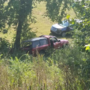 Crews investigating after pickup pulling trailer crashes, rolls down embankment