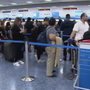 Flight cancellations snarl evacuees' efforts to return home