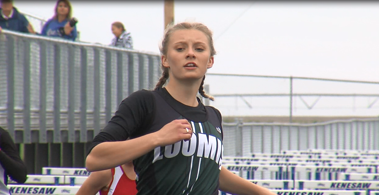 Skylar Hadley of Loomis crosses the finish line as a winner in the girls 100 M hurdles at the D8 district meet (NTV News)