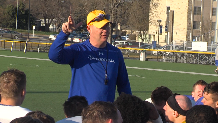 UNK football head coach Josh Lynn talks to his players after practice at Ron and Carol Cope Stadium, April 5, 2017 (NTV News)
