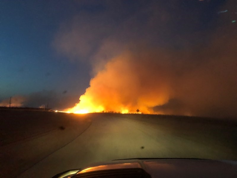 Firefighters battle grass fire near Hominy (Courtesy of Britton Redeagle)<p></p>