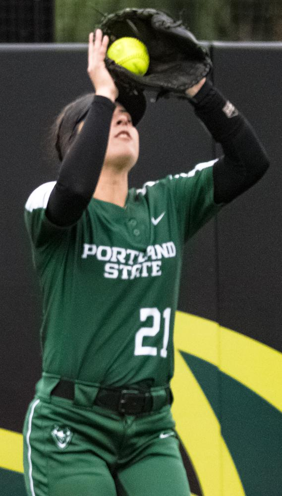 Portland State Tayler Gunesch (#21) catches a fly ball for an easy out. The Ducks are now 35-0 this season matching a NCAA record for most consecutive wins to start a season, winning the first game 3-1 then following up with a 8-0 win in the second and will next play UCLA on April 7th in Los Angeles, California. Photo by Jonathan Booker, Oregon News Lab
