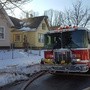 Woman sent to hospital after fire on Alphonse Street