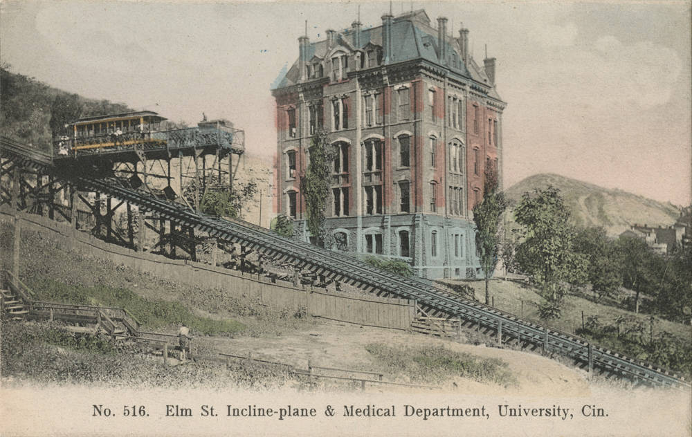 The Bellevue Incline—also known as the Elm Street Incline and Clifton Inclined Plane—opened in 1876, the same year as Mt. Adams. Though its physical length is disputed, it is understood to have been around 1000 feet long. It connected what is today's Bellevue Park to the intersection of Elm and McMicken Streets in Over-the-Rhine. The incline ran between the former Jackson Brewery and since-demolished McMicken Hall, UC's first college. The Bellevue Incline was the highest elevated of all five inclines. Because of its elevation, streetcars were stored in the top station for safe keeping during  the flood of 1937. The Bellevue House, which opened the same year as the incline, was a striking Tudor-style building designed by architect James McLaughlin. It was considered the most beautiful of all the incline houses, and served only Moerlein beer. Inside, guests could listen to music, bowl, and take in panoramic views of the city below. Bellevue House burned in 1901, and the incline closed 25 years later.{ }/ Image courtesy of the Public Library of Cincinnati and Hamilton County // Published: 1.2.19