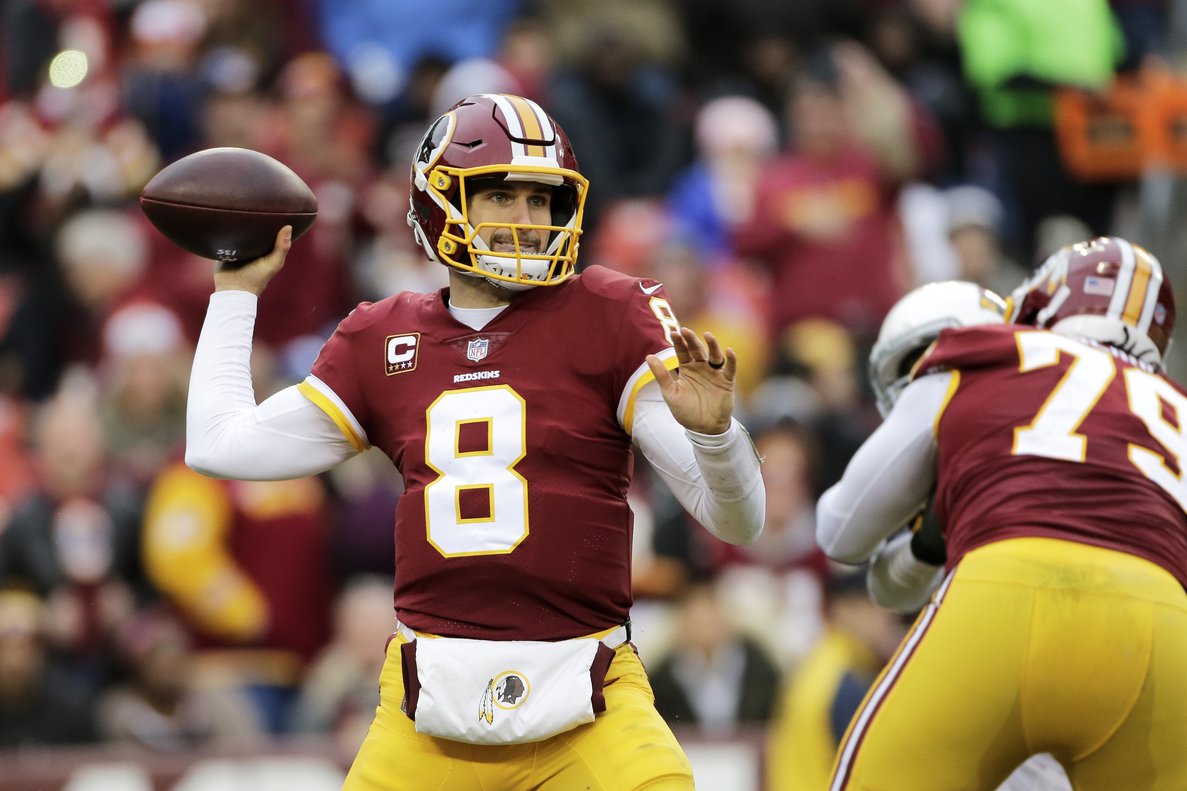 Washington Redskins quarterback Kirk Cousins (8) throws the ball during an NFL football game against the Arizona Cardinals, Sunday, Dec. 17, 2017, in Landover, Md. (AP Photo/Mark Tenally)