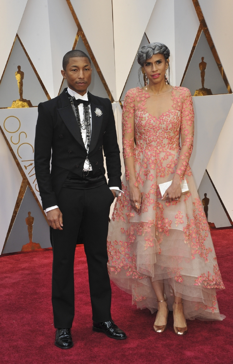 This year we saw an abundance of couples where only one of the pair hit their mark with their red carpet choices. I have to hand it to Pharrell who has thankfully ditched the hat for some lovely layered Chanel necklaces with black pearls. But I can't get behind the ensemble his producer partner Mimi Valdes donned. The high-low, floral-embellished gown did nothing for me, especially paired with those awful, chunky-heeled metallic shoes. (Image: Apega/WENN.com)