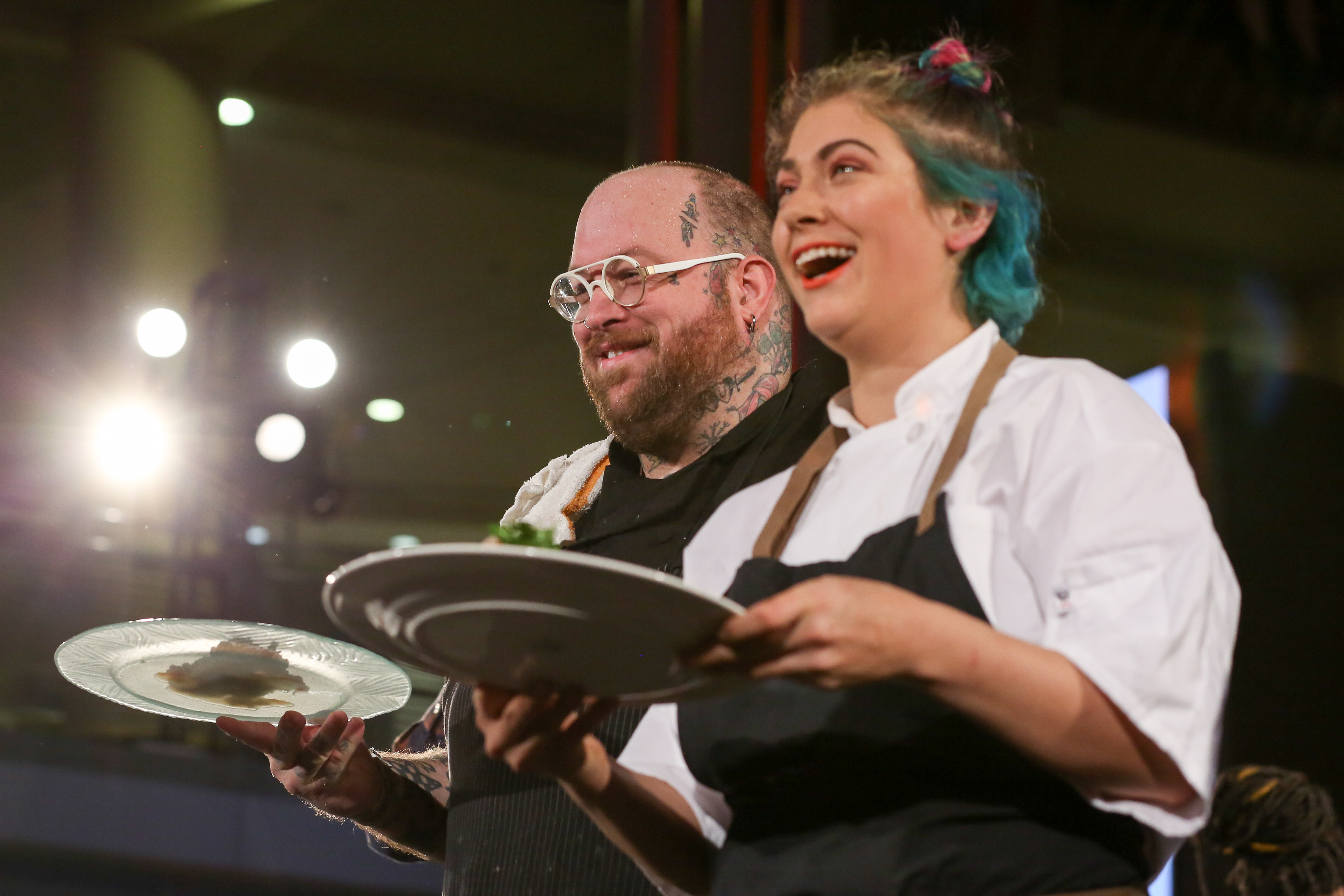 Hamilton Johnson of Honeysuckle and Miranda Rosenfelt of Sally's Middle Name present their dishes to the judges. (Amanda Andrade-Rhoades/DC Refined)<p></p>