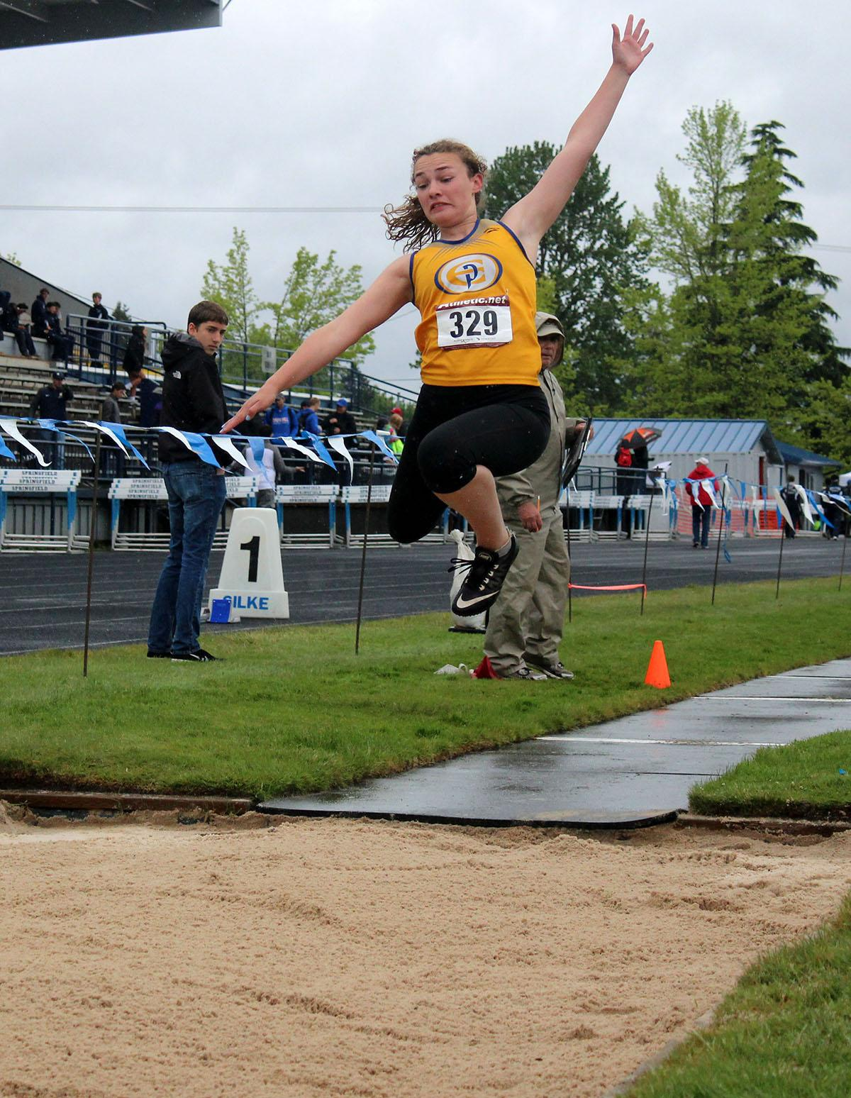 A triple jumper gives it her all at the 5A-3 Midwestern League District Track Championship meet. Photo by Elle Page, Oregon News Lab