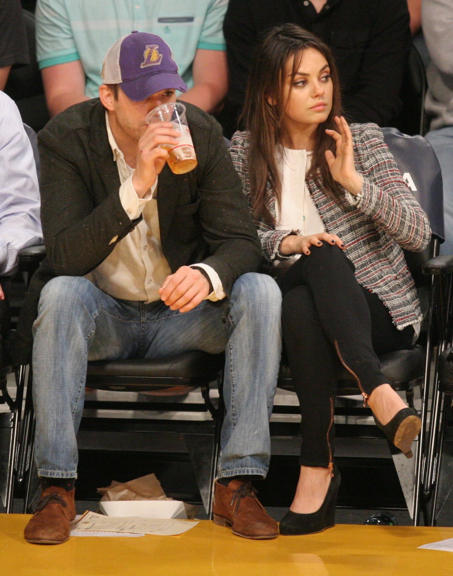 Celebrities courtside at the Los Angeles Lakers v New Orleans Pelicans NBA basketball game at the Staples Center. The Pelicans defeated the Lakers by a final score of 132-125.                                    Featuring: Ashton Kutcher, Mila Kunis                  Where: Los Angeles, California, United States                  When: 04 Mar 2014                  Credit: WENN.com