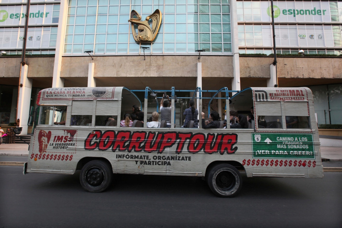"The tour bus Corruptour runs through the streets in Mexico City, Sunday, Feb. 5, 2017.  This is the newest addition to the ubiquitous open-air tour buses that crisscross Mexico City each day: The Corruptour, which instead of taking folks to historic plazas and churches, shines an unflattering spotlight on the murky world of graft. They also engage with bemused bystanders along the route, coaxing pedestrians and taxi drivers to join in chanting ""No more corruption!"" (AP Photo/Marco Ugarte)"