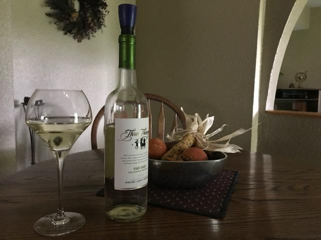 A bottle of Pino Grigio topped with a Repour wine saver after opening. Repour works well for both white and red wines.