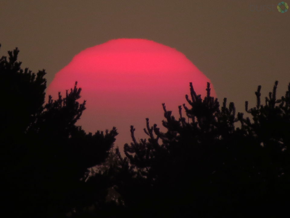 Debbie Tegtmeier shared these photos of Sunday's smoky sunset in Winchester Bay, Oregon, via BURST.com/KVAL.