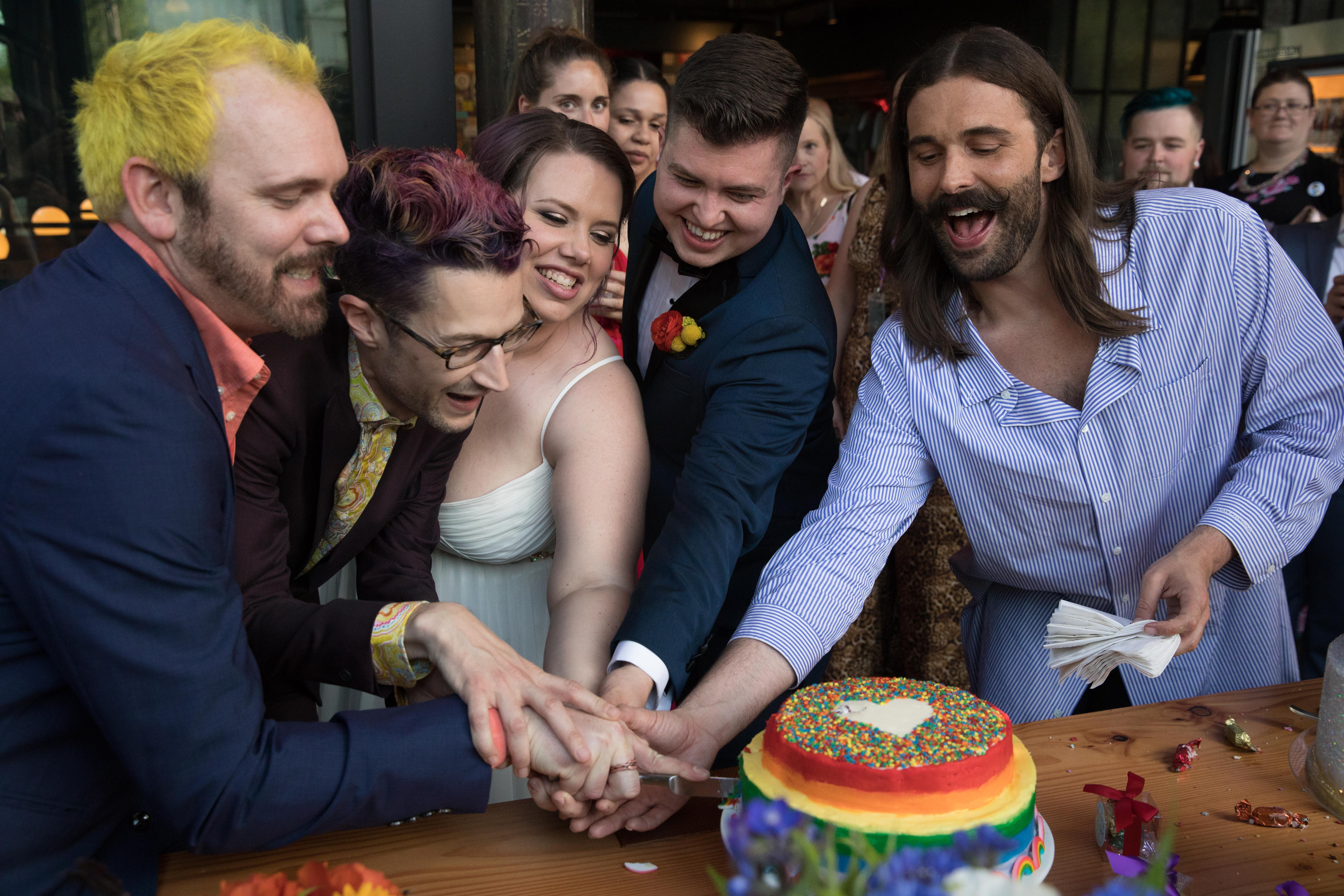 CAN YOU EVEN BELIEVE?!{ } #MarryUsJVN contest winners, Megan (middle) and Haden (middle-right), cut wedding cakes from various LGBTQ+ friendly bakeries, after being officiated by LGBTQ+ advocate Jonathan Van Ness (right) at Elysian Brewing's Capitol Hill brewpub in Seattle, Washington on June 4, 2019. (Photo by Matt Mills McKnight/Invision for Elysian Brewing/AP Images)