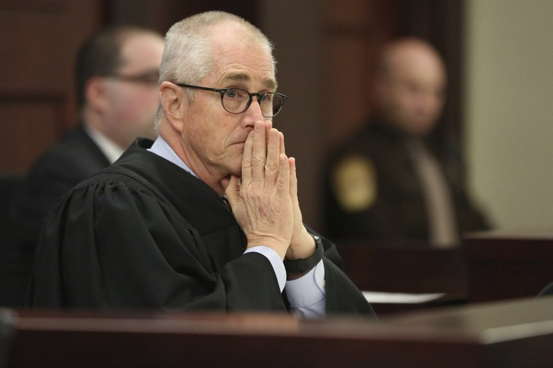 Judge Robert Turk listens as attorneys speak in Montgomery County Circuit Court in Christiansburg, Va., Wednesday, Feb. 7, 2018. Defendant David Eisenhauer is accused of killing 13-year-old Nicole Madison Lovell on Jan. 27, 2016. (Matt Gentry/The Roanoke Times via AP, Pool)