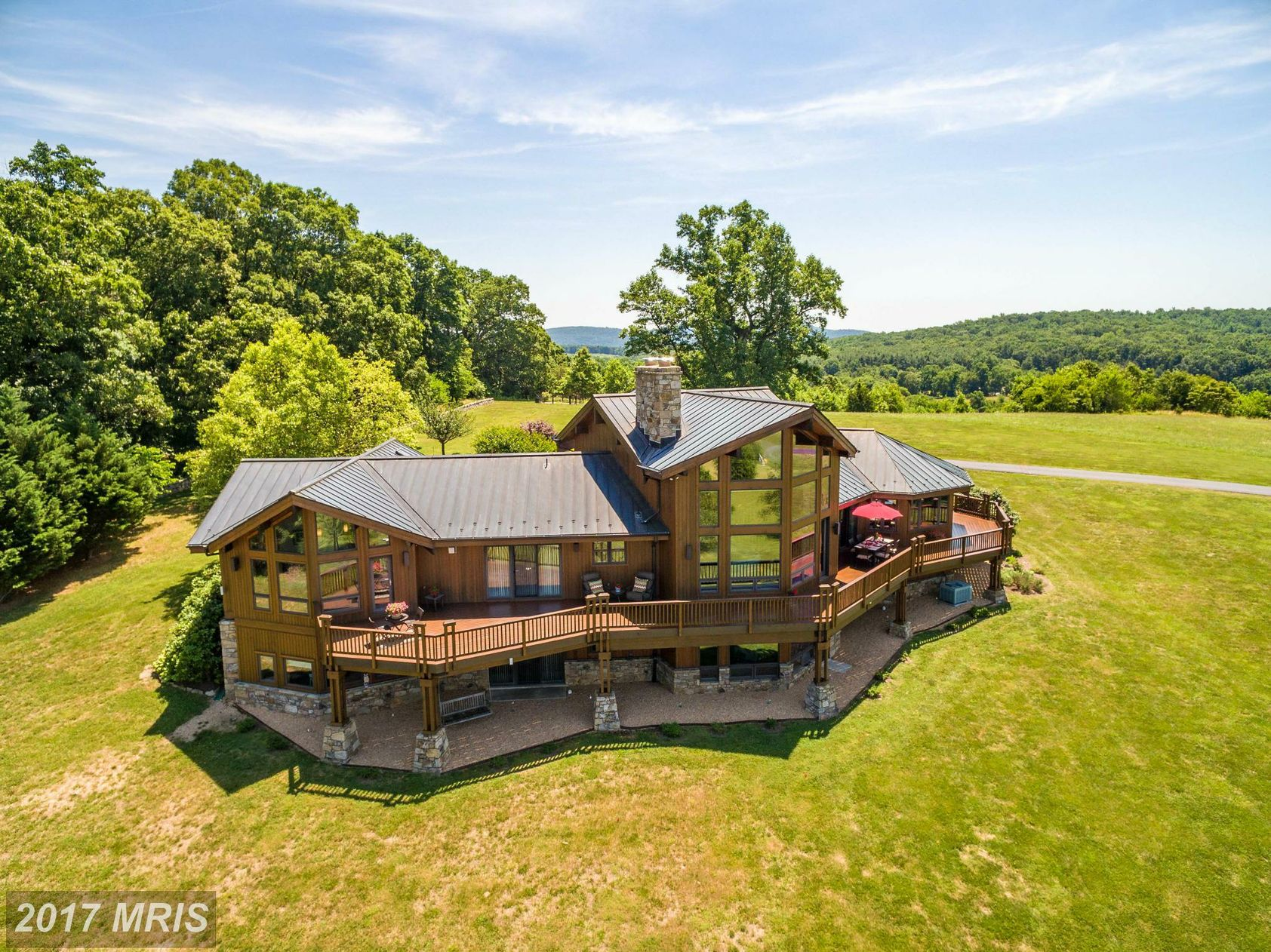I am a city girl through and through, but I would give it all up in a heartbeat to live in this beaut! Mt. Jett Farm is a 7,000-square-foot custom home sited on 118 acres in Marshall, VA at the foothills of the Blue Ridge Mountains. Everywhere you turn, you're surrounded by custom woodwork and expansive views of the rolling hills of Dixon Valley. Plus, you're only a stones throw away from Red Truck Bakery and Field & Main! It's luxury country living at its finest and yet it's still only an hour drive from the city. Listed by Barbara Patton and Lynn Hoover of McEnearney Associates, this four-bedroom/five-bath farm retreat is almost a steal at $2,650,000. Enjoy our gallery and visit mcenearney.com for more info on the lot! (Image: Courtesy McEnearney Associates)