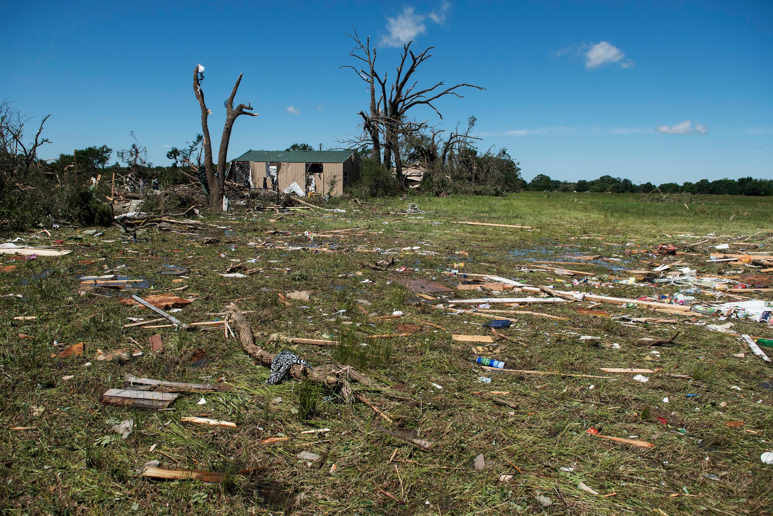 Debris lies on the ground in Canton, Texas on Sunday, April 30, 2017. Severe storms including tornadoes swept through several small towns in East Texas, killing several people, and leaving a trail of overturned vehicles, mangled trees and damaged homes, authorities said Sunday. (Sarah A. Miller/Tyler Morning Telegraph via AP)