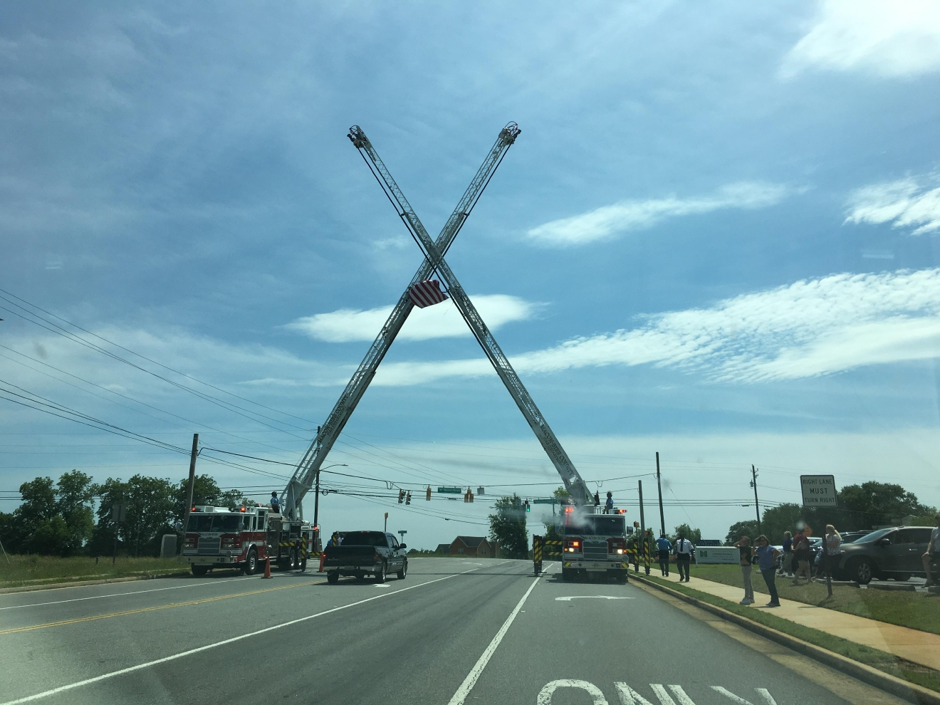 "Macon-Bibb County firefighters honored fallen deputy investigator Anthony ""TJ"" Freeman during the processional from the Centreplex to the graveyard on Monday / Eric Mock (WGXA)"