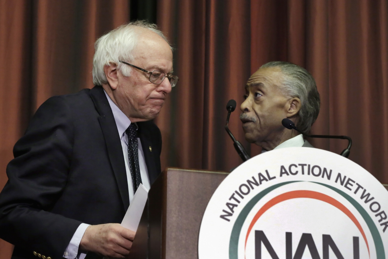 Democratic presidential candidate, Sen. Bernie Sanders, I-Vt. is introduced by the Rev. Al Sharpton during the 25th annual National Action Network convention in New York,  Thursday, April 14, 2016. (AP Photo/Richard Drew)