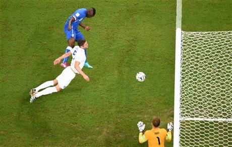 Italy's Mario Balotelli, top, scores his side's 2nd goalduring the group D World Cup soccer match between England and Italy at the Arena da Amazonia in Manaus, Brazil, Saturday, June 14, 2014.