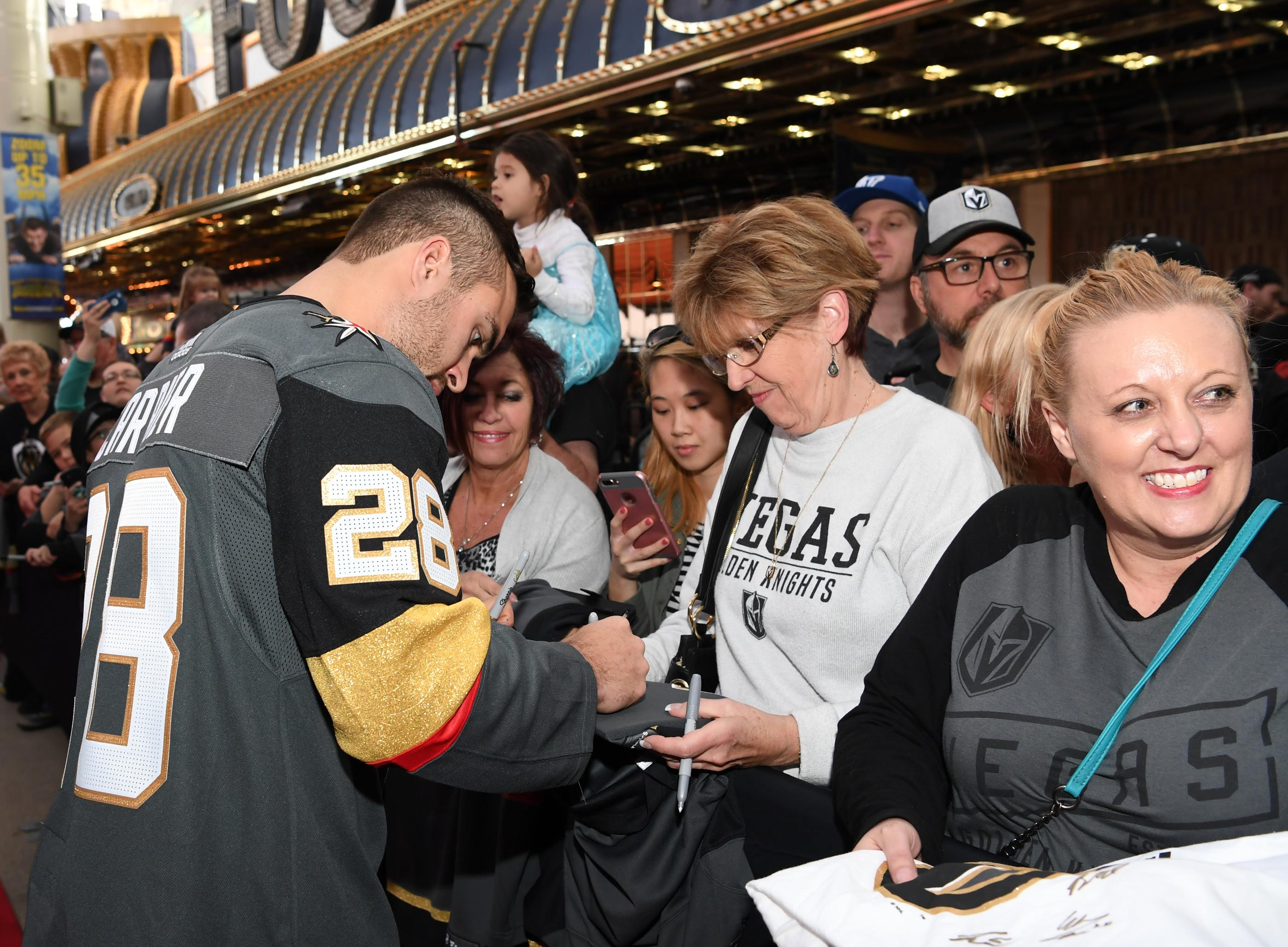The Golden Knights host a Fan Fest with the D Las Vegas and Fremont Street Experience. Las Vegas Golden Knights player William Carrier signs a fans shirt at Fremont Street Experience. Sunday, January 14, 2017. CREDIT: Glenn Pinkerton/Las Vegas News Bureau